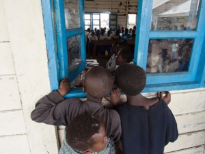 Children sneaking in a classroom