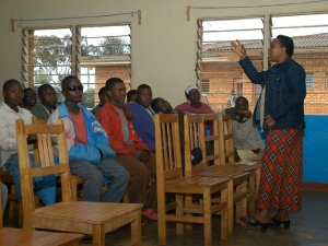 A teacher explaining about AIDS prevention in the classroom