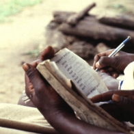 A boy writing in his notebook